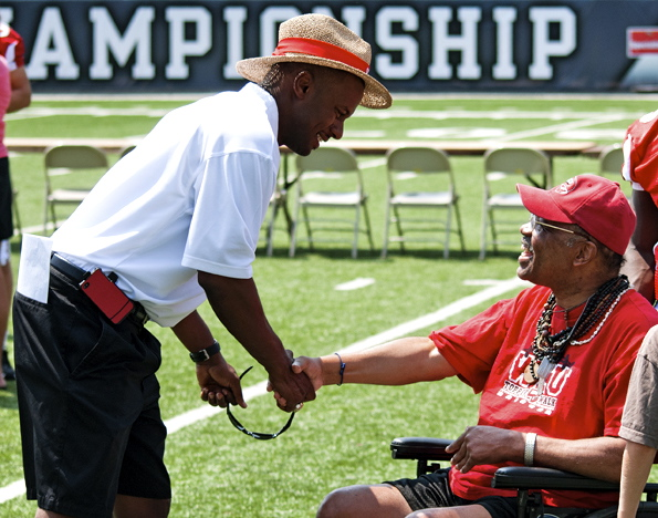 Head+Coach+Willie+Taggart+shakes+hands+with+Darryl+Smith+of+Bowling+Green%2C+a+former+football+player+at+WKU%2C+Saturday+at+Family+Fun+Day+in+Smith+Stadium.+%22Western+football+helped+shape+my+life%2C%22+Said+Smith.+%22It+made+me+who+I+am+today.%22