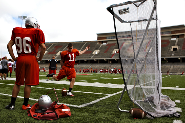 Redshirt freshman Monte Merrick practices placekicking while Kevin Carillo, a true freshman kicker, gazes on. The two have split kicking reps in Western's fall camp since starting kicker Casey Tinius has been sidelined with a groin injury.