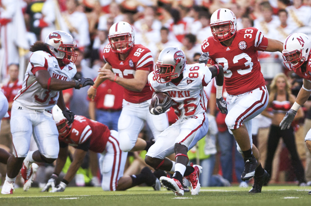 Freshman wide receiver Willie McNeal returns the ball up-field on a punt return against the Huskers during Saturday's game at Memorial Stadium in Lincoln, Neb.