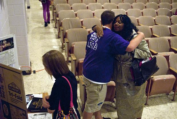 Thomas Bolen, a junior from Louisville, hugs Sheila Holt-Orstead, the main speaker of