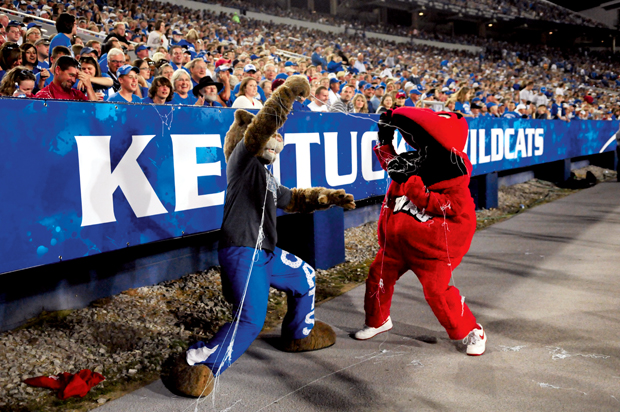 Big+Red+takes+silly+string+to+the+mouth+from+the+Kentucky%27s+mascot%2C+the+Wildcat%2C+to+entertain+those+close+to+the+sideline+at+the+WKU-UK+game+on+Sept.+27%2C+2008.+The+Toppers+lost+in+the+team%27s+only+meeting+41-3.