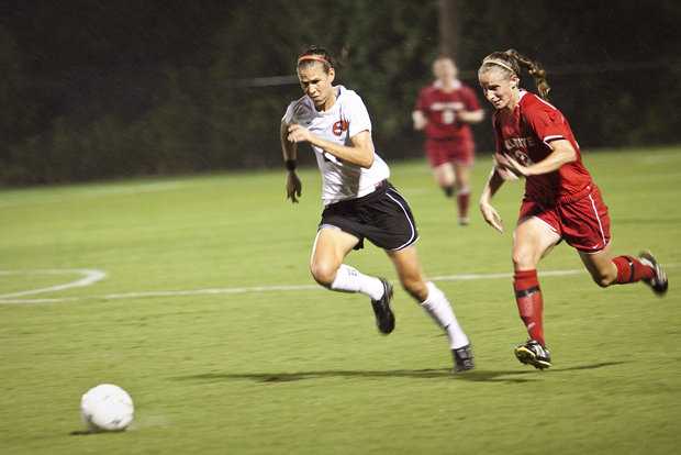 WKU Junior forward Kaylyn Pratt fights for possession with a Ball State defender Friday night. The Lady Toppers gave up a goal in the 33rd minute and went on to lose the game, 1-0, to mark their third loss of the seaon. Although it rained for the majority of the game, Head Coach Jason Neidell said that the weather