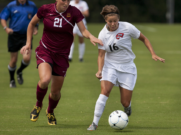 Junior forward Mallory Outerbridge battles to protect the ball against Minnesota senior defender Kylie Kallman during their match on Sunday at the WKU Soccer Complex. Outerbridge was credited with the Lady Toppers' only goal, a corner kick in the 80th minute.