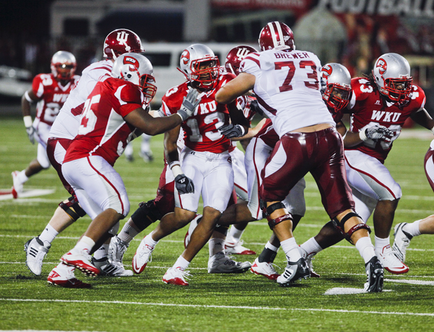 Freshman linebacker Xavius Boyd is blocked while attempting to stop Indiana University's offensive drive in the late in the second half on Saturday at Houchens-Smith Stadium.  The Toppers lost 21-38.