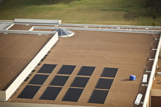 Solar+collectors+soak+in+light+early+in+the+morning+on+the+roof+of+the+Preston+Center.++The+88+panels%2C+installed+last+week%2C+heat+the+swimming+pool+in+the+facility.+The+panels+will+save+WKU+at+least+%2410%2C963+annually%2C+according+to+Dale+Dyer%2C+plant+operations+manager+for+WKU+Facilities+Management.++CHRIS+WILSON%2FHERALD