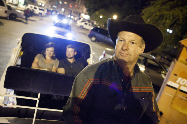 James Beckner (right), of Rockfield, drives Jeremy and Meg Rodgers (left), of Bowling Green, around Fountain Square Park on a downtown carriage ride Friday night. Beckner and his family run Rockin' B Horse and Carriage and spend their Friday and Saturday nights giving carriage rides around downtown Bowling Green. CHRIS FRYER/HERALD