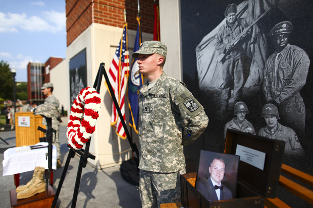 ROTC Cadet Justin Powell stands guard at a memorial service for 1st Lt. Eric D. Yates at Guthrie Bell Tower on Thursday. Yates graduated in 2008 with a degree in social studies and history. Luke Sharrett/Herald
