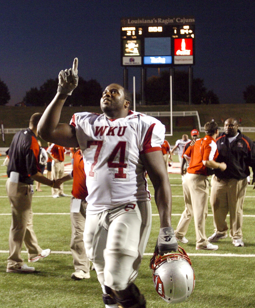 Senior offensive lineman Mychal Patterson points to the heavens after WKU won its game Saturday against Louisiana-Lafayette. WKU defeated ULL 54-21 to snap a 26-game losing streak.
