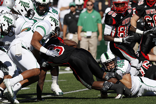 North+Texas+line+backer+Jeremy+Phillips+brings+down+WKU+running+back+Bobby+Rainey+during+Saturday%27s+Homecoming+game.+WKU+lost+33-6.
