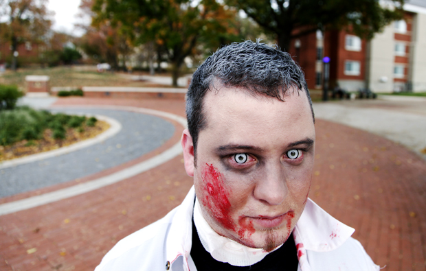 25 year old John Madrigal of Bowling Green coordinated the first annual WKU Zombie Walk in which close to fifty people participated. Participants dressed in zombie attire and walked from Centennial Mall on WKU's campus to the downtown square and back. TIM HARRIS/HERALD