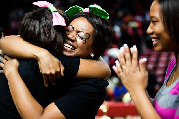 Senior Ashlyn Lyles of Alpha Kapa Alpha hugs her sorority sister after winning Saturday night's Step Show.  The girls haven't won in three years.