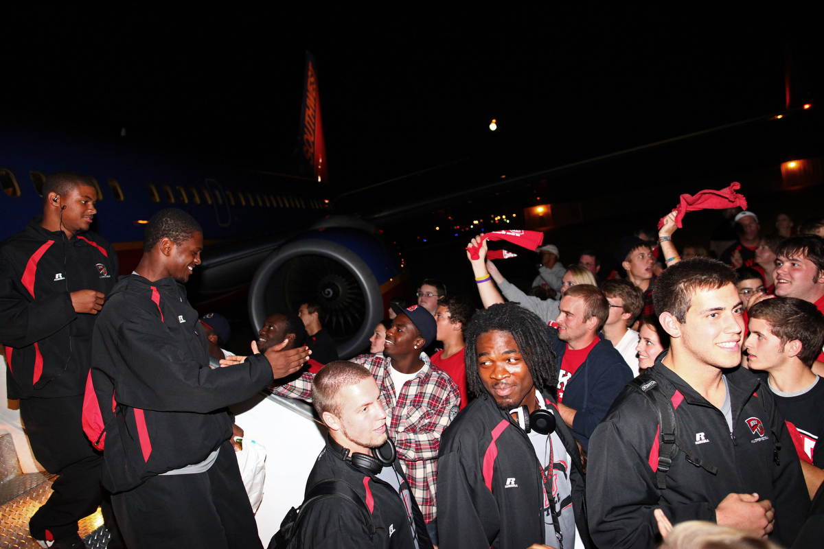 The WKU football team is greeted by a cheering crowd at Bowling Green Regional Airport following its first win in 26 games, Saturday, Oct. 23, 2010.