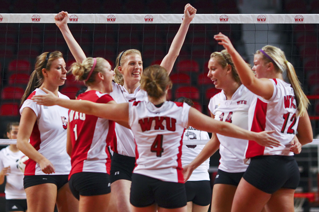 The Lady Toppers celebrate the winning point in their 3-0 sweep against Louisiana-Monroe Saturday in Diddle Arena. WKU has won its last six Sun Belt Conference matches.