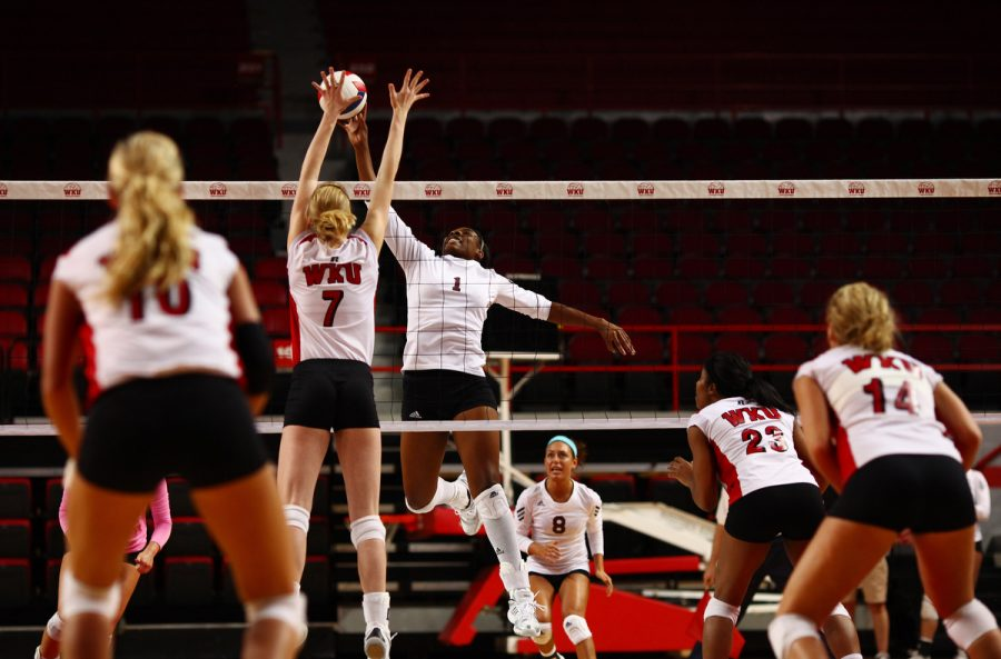Junior middle hitter Tiffany Elmore jumps for a block at the net during the Lady Toppers' 3-0 win against Louisiana-Monroe at home in Diddle Arena Saturday, Oct. 23, 2010.