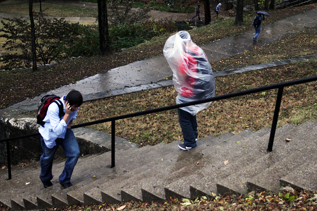 A student leaves FAC using a garbage bag as a raincoat during the sever weather on Tuesday. JAKE STEVENS/HERALD