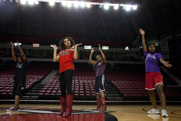 Delta Sigma Theta sorority sisters (from left) Tabnie Dozier, a senior from Lexington, Ky., Kelcie Swogger a senior from San Antonio, Texas, Teranie Thomas a junior from Dallas, Texas, and Rae Daniel a senior from Cincinnati, Ohio, practice together for their upcoming step show Monday, Oct. 18, in Diddle Arena.  The sorority has been practicing since June for the show which is set to take place Homecoming weekend. Delta Sigma Theta will be stepping against Alpha Kappa Alpha sorority for the 40th anniversary of Delta Sigma Theta.  ALYSSA ORR/HERALD