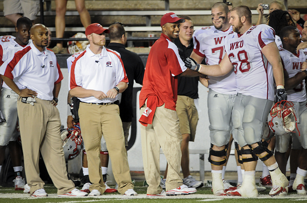 Head+Coach+Willie+Taggart+celebrates+with+senior+offensive+lineman+Preston+King+on+the+sidelines+at+the+end+of+the+Toppers%27+game+Saturday+at+Louisiana-Lafayette.+WKU+defeated+ULL+54-21%2C+the+team%27s+first+win+after+losing+26+games.
