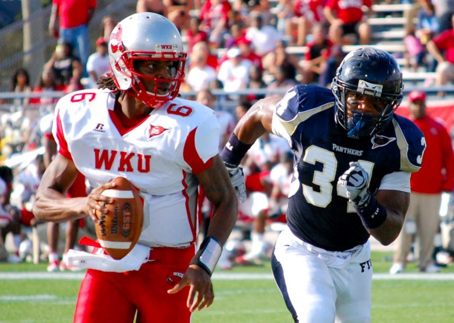 Sophomore quarterback Kawaun Jakes evades FIU sophomore linebacker Winston Fraser during WKUs 28-21 loss to the Panthers at FIU Field. The Toppers had a shot at tying late in the fourth quarter, but redshirt freshman receiver Willie McNeal dropped a fourth-down pass from Jakes in the endzone.