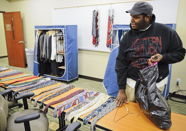 Jordan Pitney, a junior from Louisville, packs up his newly acquired business clothes. The Hire Attire Career Closet at Career Services takes donations from the community and gives them to students at WKU who need nicer clothing for job interviews. JOSH MAUSER/HERALD
