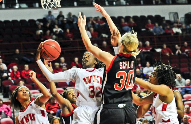 HERALD FILE PHOTO Senior forward Arnika Brown grabs a rebound over Arkansas State forward Lyndsay Schlup during the second half of a Feb. 10 game at Diddle Arena.  Brown grabbed 24 rebounds during WKU's 83-78 win over Arkansas State.