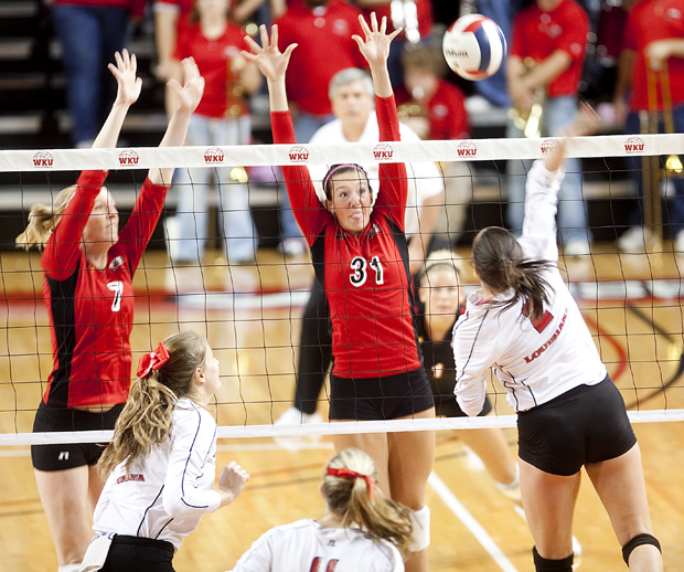 Junior Tiffany Elmore (left) and senior Emily Teegarden (right) post a block during the game of WKU's 3-0 sweep against Louisiana-Lafayette on Friday, Oct. 22.
