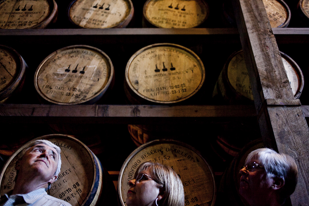Tourists gaze up at the rows of bourbon barrels in the rick house at the Woodford Reserve distillery in Versailles. Woodford Reserve is one of six distilleries on the Kentucky Bourbon Trail.