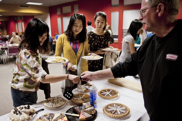 International students get advice while choosing desserts at the International Thanksgiving dinner held at the Baptist Campus Ministry on Sunday.  More than a hundred students attended the free dinner, while several BCM members and WKU faculty volunteered to serve food.