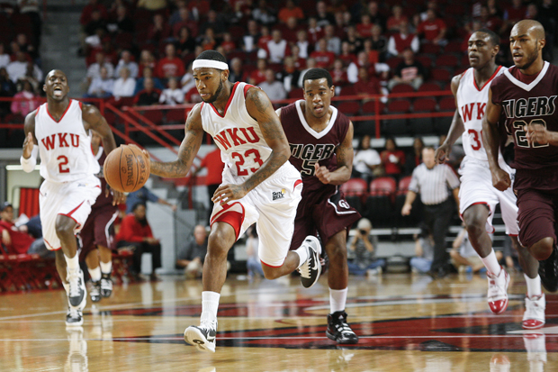 WKU+guard+Brandon+Peters+drives+down+the+court+during+Sundays+first+home+exhibition+game+of+the+season.+WKUs+next+home+game+will+host+Xavier+at+home+on+Thursday+Nov.+4.
