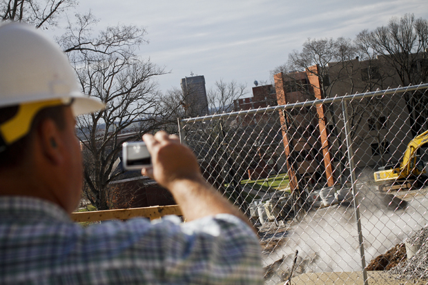 Chris Morris of Pulaski, Tenn. shoots video of a controlled explosion outside the fine arts center on Monday morning.