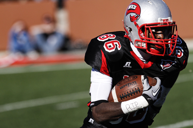 Freshman receiver Willie McNeal carries the ball in WKU's loss on Homecoming. McNeal caught the game-tying score in the fourth quarter of WKU's 36-35 win Saturday at Arkansas State.