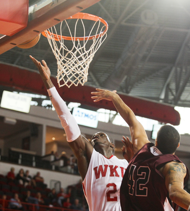 Senior+forward+Juan+Pattillo+drives+down+the+lane+against+Campbellsville+during+Sunday%27s+exhibition+game+in+Diddle+Arena.+Pattillo+scored+17+points+and+had+10+rebounds+in+his+WKU+debut.+The+Toppers+won+80-57.