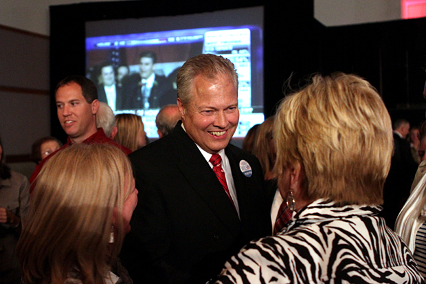 Mike Wilson talks with Rand Paul supporters at during Paul's election party at the Sloan Convention Center in Bowling Green.