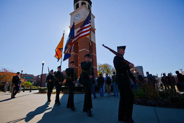 Members of the WKU ROTC color guard walk away from Guthrie Bell Tower following a Veterans Day wreath-laying ceremony on Thursday morning. Veterans Day, formerly known as Armistice Day, marks the anniversary of the end of World War I.