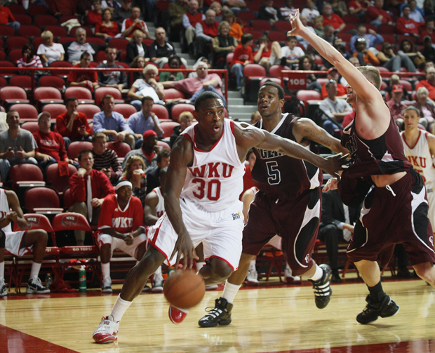 WKU senior forward Steffphon Pettigrew drives the ball towards the basket in the second half of WKU's season opening exhibition game against Campbellsville. Pettigrew scored a team-high 23 points to lead WKU in an 80-57 win.