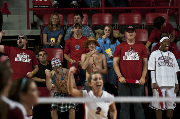 Zack Rockrohr, 21 of Delavan Ill., cheers on the WKU volleyball team during their match on Friday Night in Diddle Arena.
