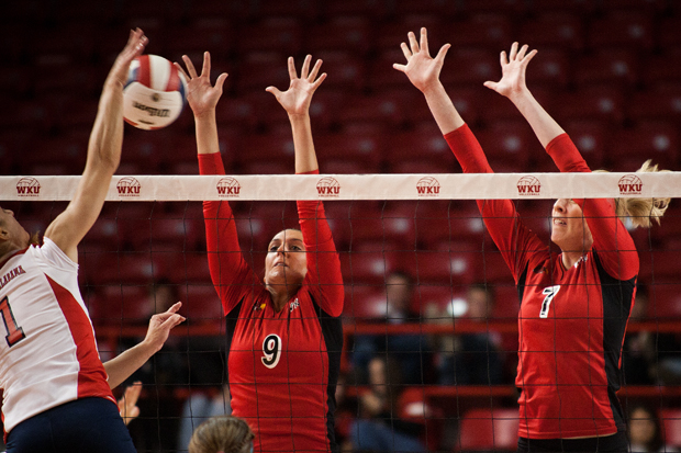 Redshirt freshman outside hitter Paige Wessel (center) and junior middle hitter Tiffany Elmore attempt to block a kill from South Alabama's outside hitter Samia Salomao on Saturday at Diddle Arena.  WKU won 3 sets to none.