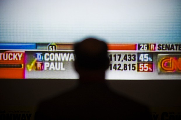 Prestonsburg+resident+Ned+Pillersdorf+watches+a+projector+of+CNN+at+the+Louisville+Marriott+Downtown+as+exit+polls+from+across+the+state+put+Rand+Paul+ahead+of+Jack+Conway.+%22It%27s+like+watching+a+funeral%2C%22+Pillersdorf+said.+%22I+was+hoping+the+polls+were+wrong.%22