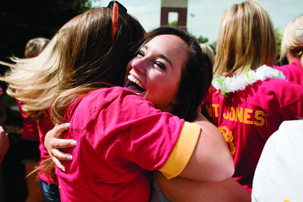 """Louisville freshman Katie Engel accepts her bid into Chi Omega in August with a hug from her new sorority sister.  """"I was really happy and excited, """" Engel said. """"I didn't know who she was, I just ran up and hugged her."""" The sorority recruitment process will change for fall 2011."""