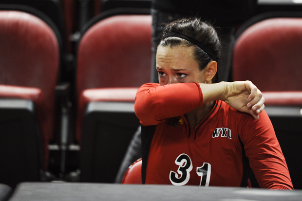 Senior outside hitter Emily Teegarden struggles to hold back tears following WKU's match against MTSU. The loss was Teegarden's final home match.