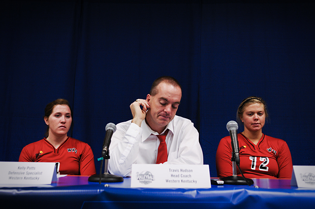From left, defensive specialist Kelly Potts, Head Coach Travis Hudson and outside hitter Jordyn Skinner speak at a press conference after their 3-0 loss to Cincinnati in the first round of the NCAA tournament.