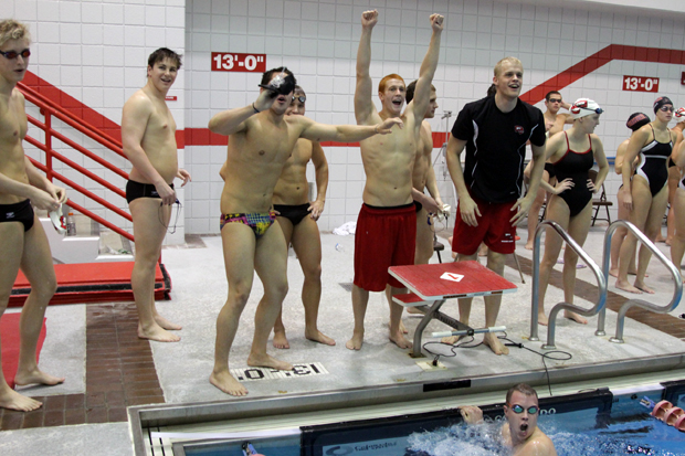Sophomore+Billy+Kunkel+checks+his+time+after+winning+the+200-meter+freestyle+in+a+meet+against+the+University+of+Evansville+at+the+Preston+Center+on+Saturday.+The+WKU+men%27s+and+women%27s+teams+won+to+extend+their+streak.