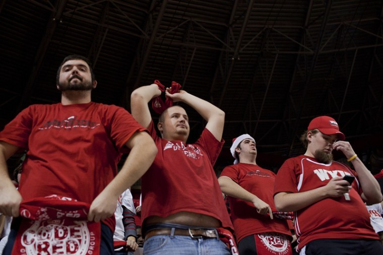 WKU fans in the student section show their disappointment in the Toppers' performance on Wednesday night against Louisville.  Cody Sparks (far right), a senior from Beaver Dam, got to the game at 10 a.m. to get front-row seats. The attendance in Diddle Arena was 7,326.