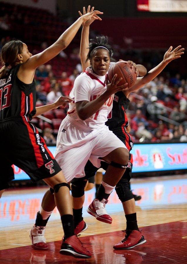 Junior forward Keisha Mosley fights off multiple defenders during Wednesday nights game against Texas Tech. Mosley ended the night with a game-high 20 points, but the Lady Toppers lost the game, 70-60.