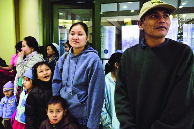 """Burmese refugees arrive on a school bus to Mass Media Auditorium at about 5 p.m. on Wednesday for the """"Forced From Our Villages: The Karenni Community Journey From Burma to Bowling Green"""" event. Refugees also prepared food to share with the students and community."""