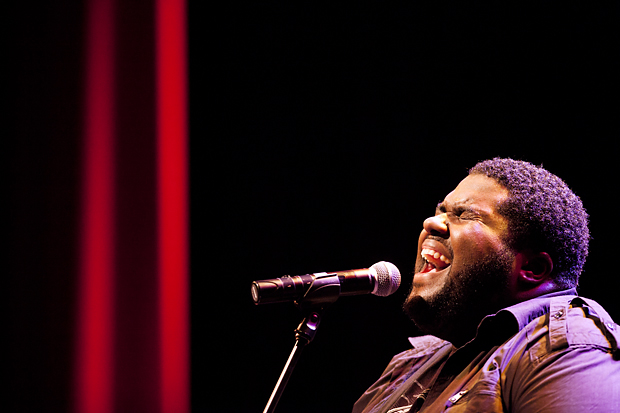 Atlanta singer and songwriter Chinua Hawk performs a gospel song during his set at the WKU Campus Activity Board's holiday concert in the Van Meter Auditorium on Wednesday evening. The WKU Amazing Tones of Joy also performed during the concert, which about 50 people attended.