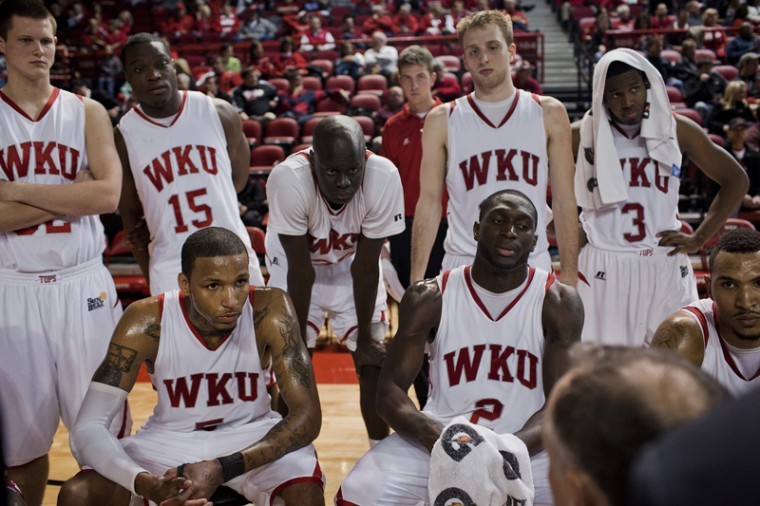 The+Toppers+listen+to+coach+McDonald+during+a+timeout+late+in+their+game+against+the+Louisville+on+Wednesday+night.++WKU+lost+114-82.