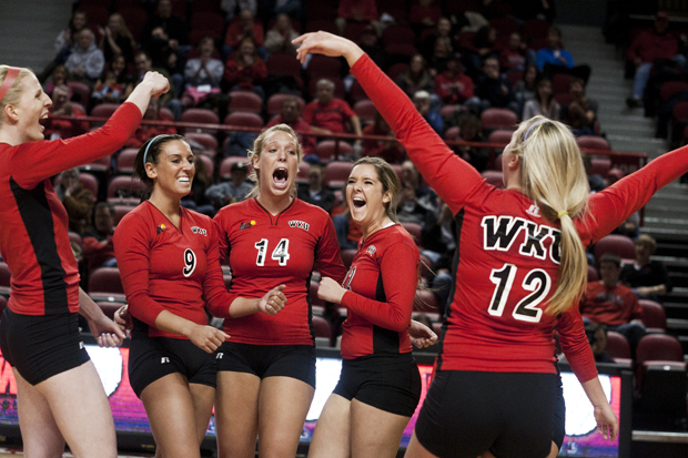 Sophomore outside hitter Jordyn Skinner hits against Cincinnati players (from left) Stephanie Niemer and Becca Refenes during the Lady Toppers home volleyball game against the Cincinnati Bearcats Oct. 19 in Diddle Arena. WKU lost 1-3.
