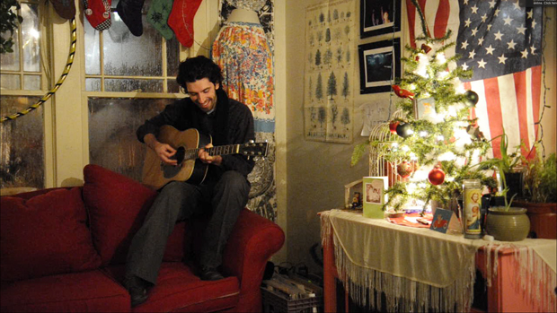 Louisville senior Joey Coe plays a song he wrote inside the Beardy Poe, a friend's home where Coe has spent a lot of time over the years. Coe is currently working on an album that's inspired by his life in Kentucky and his time spent at places like the Beardy Poe.
