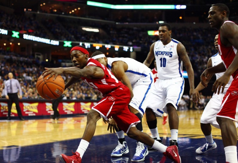 Junior+guard+Ken+Brown+saves+a+ball+from+going+out+of+bounds+under+Memphis%27+basket+Saturday+night+at+the+FedEx+Forum+in+Memphis%2C+Tenn.%2C+December+4%2C+2010.+WKU+lost+77-61.