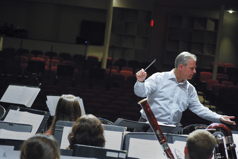 Associate+music+professor+Gary+Schallert+conducts+WKU+band+students+during+a+rehearsal+for+Friday%27s+PRISM+concert+in+Van+Meter+Auditorium+on+Wednesday.